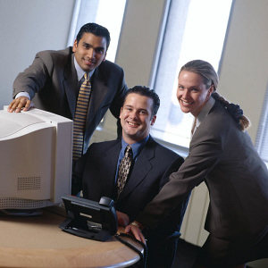 Office workers around a computer.jpg